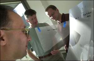 Professor Mike Stratton (foreground), Dr Richard Wooster (centre) and Dr Andy Futreal of the Cancer Genome Project at The Wellcome Trust Sanger Institute.